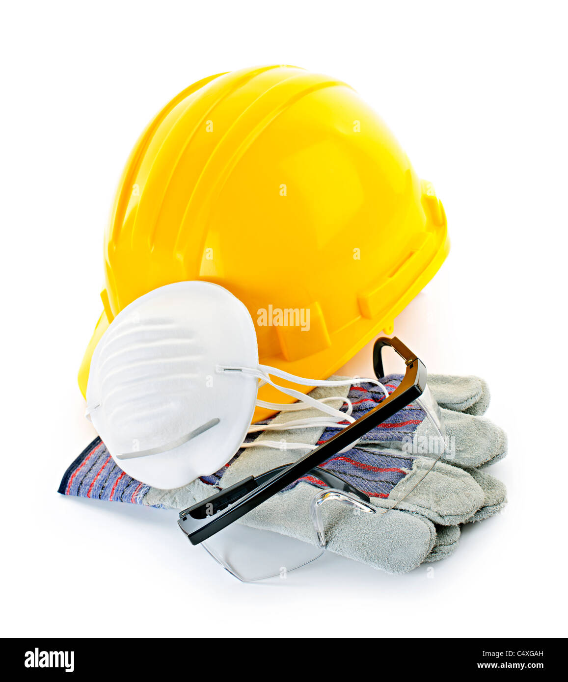 Construction safety equipment with hard hat, respirator, goggles and gloves isolated on white - Stock Image