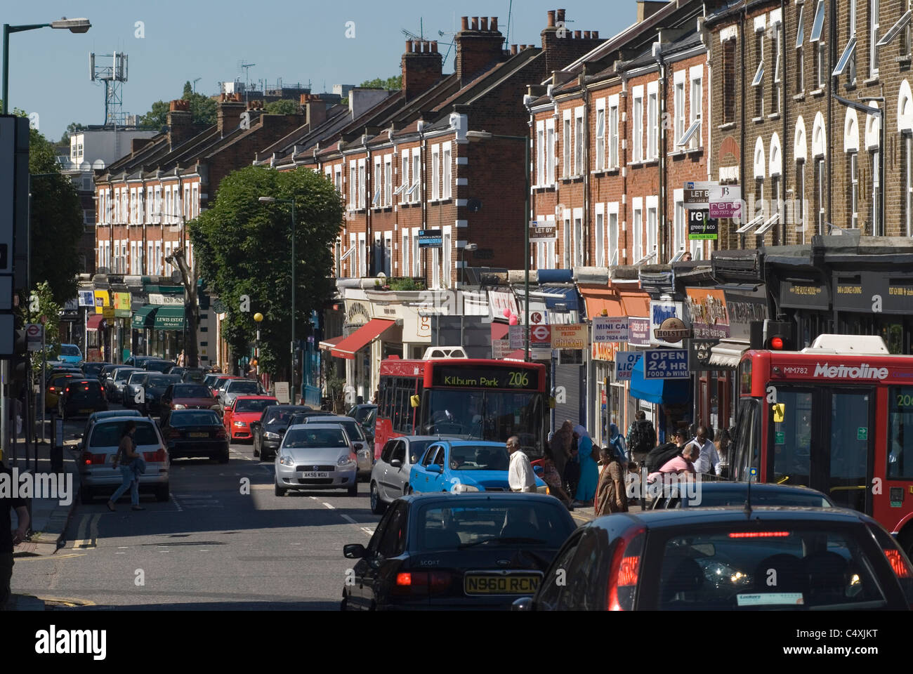 Salusbury Road, Queen's Park, NW6 North West London's  is the high street  north London UK. Traffic congestion - Stock Image
