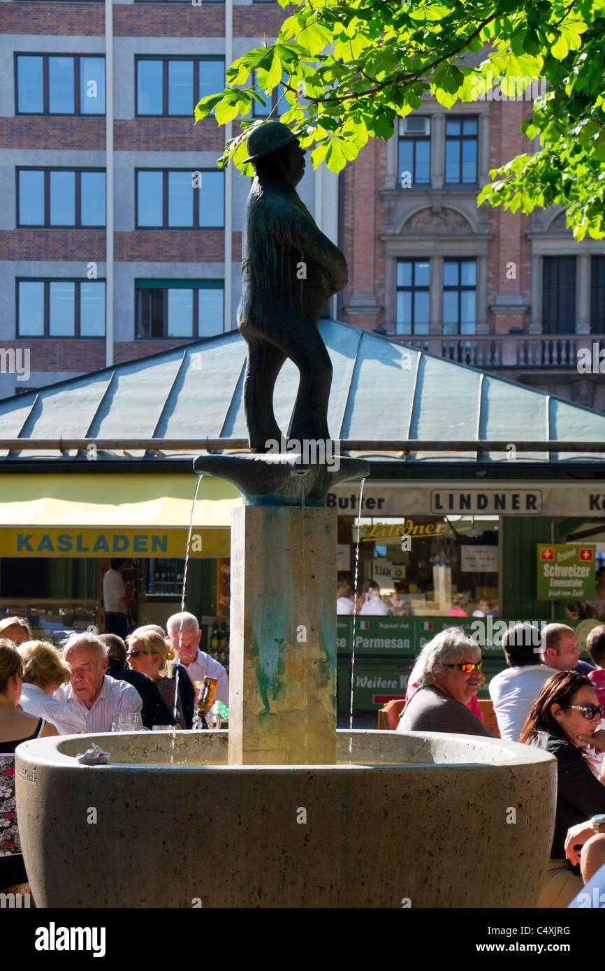 Sculpture of Weiss Ferdl, at the Viktualienmarkt in Munich, Bavaria, Germany. - Stock Image