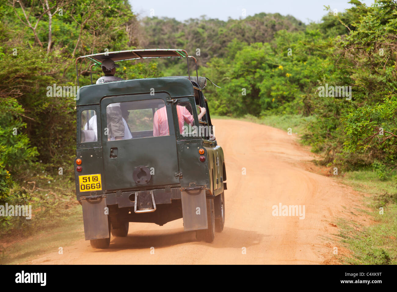 Eco tourists wildlife tourists in jeep vehichle in the jungle - Stock Image