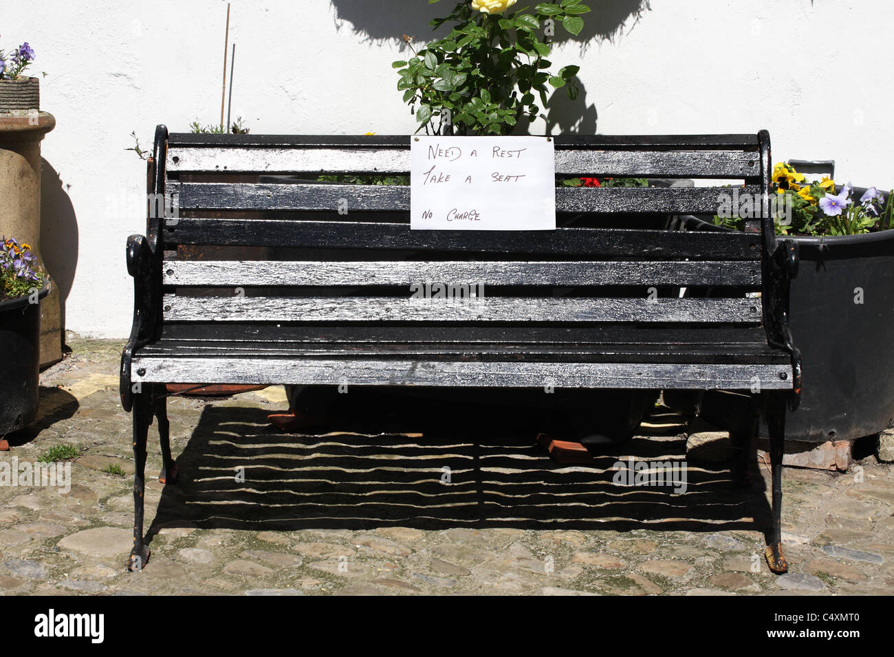 A bench to sit upon free of charge on a steep hill within Richmond, North Yorkshire, England, UK Stock Photo
