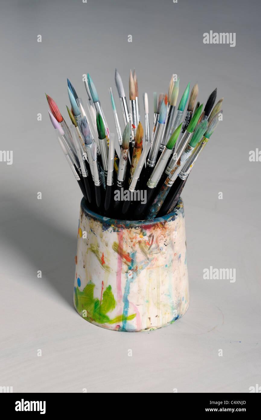Pot of paintbrushes - Stock Image