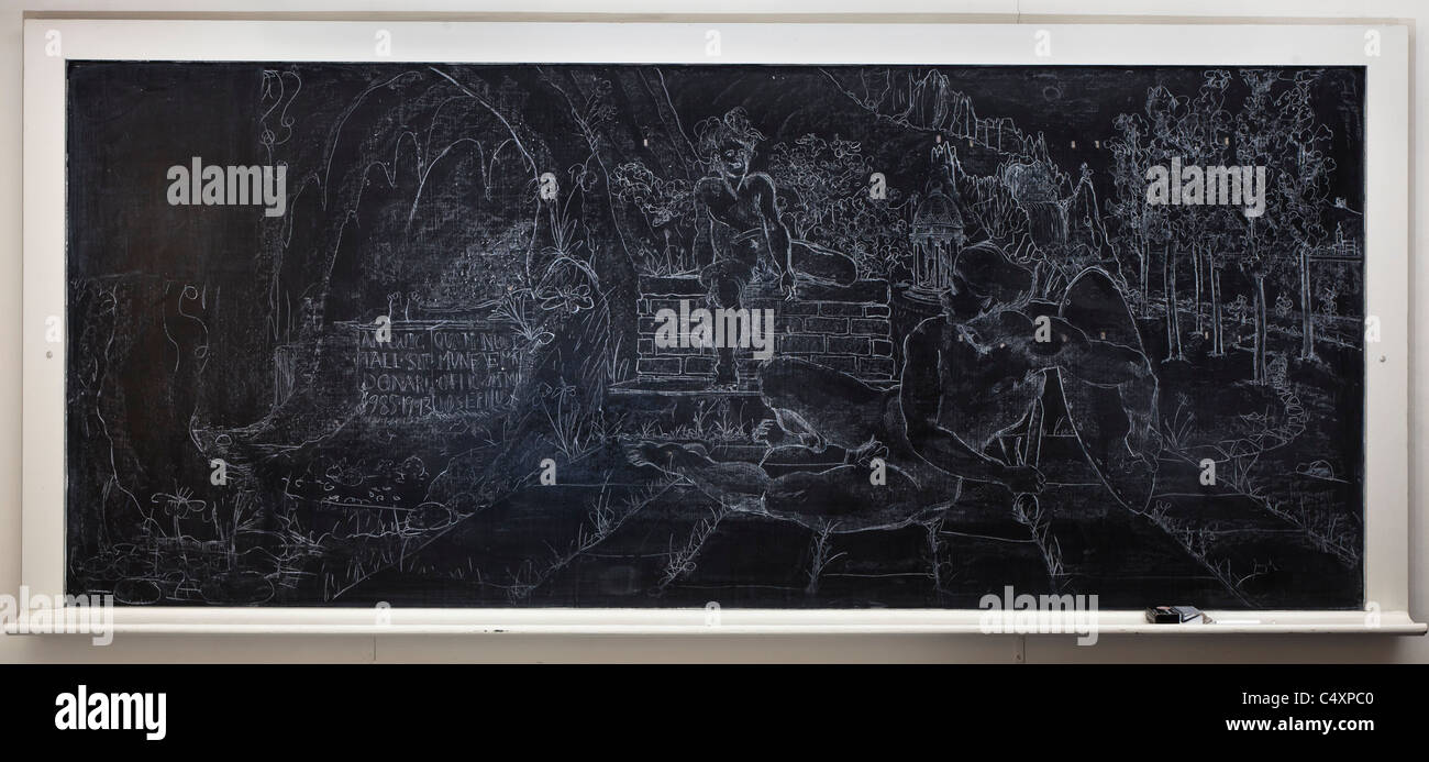 An elaborate chalk drawing on a blackboard. Partially erased at left. Box of chalk at right. - Stock Image