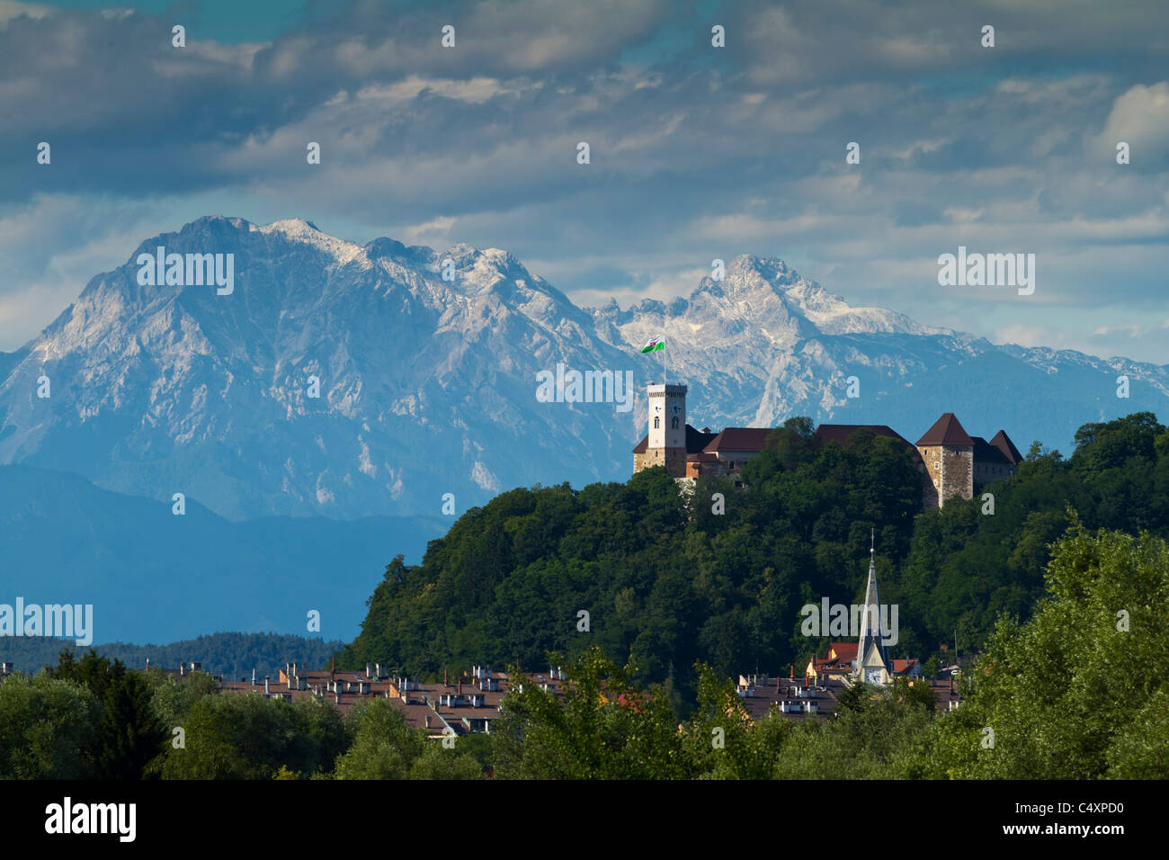 Ljubljana Castle, Slovenia, with the Kamnik Alps behind it. - Stock Image