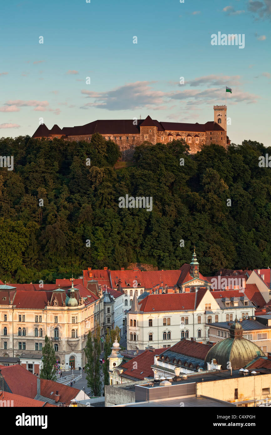 Ljubljana Castle, Slovenia, at sunset with the old town of Ljubljana below it. - Stock Image