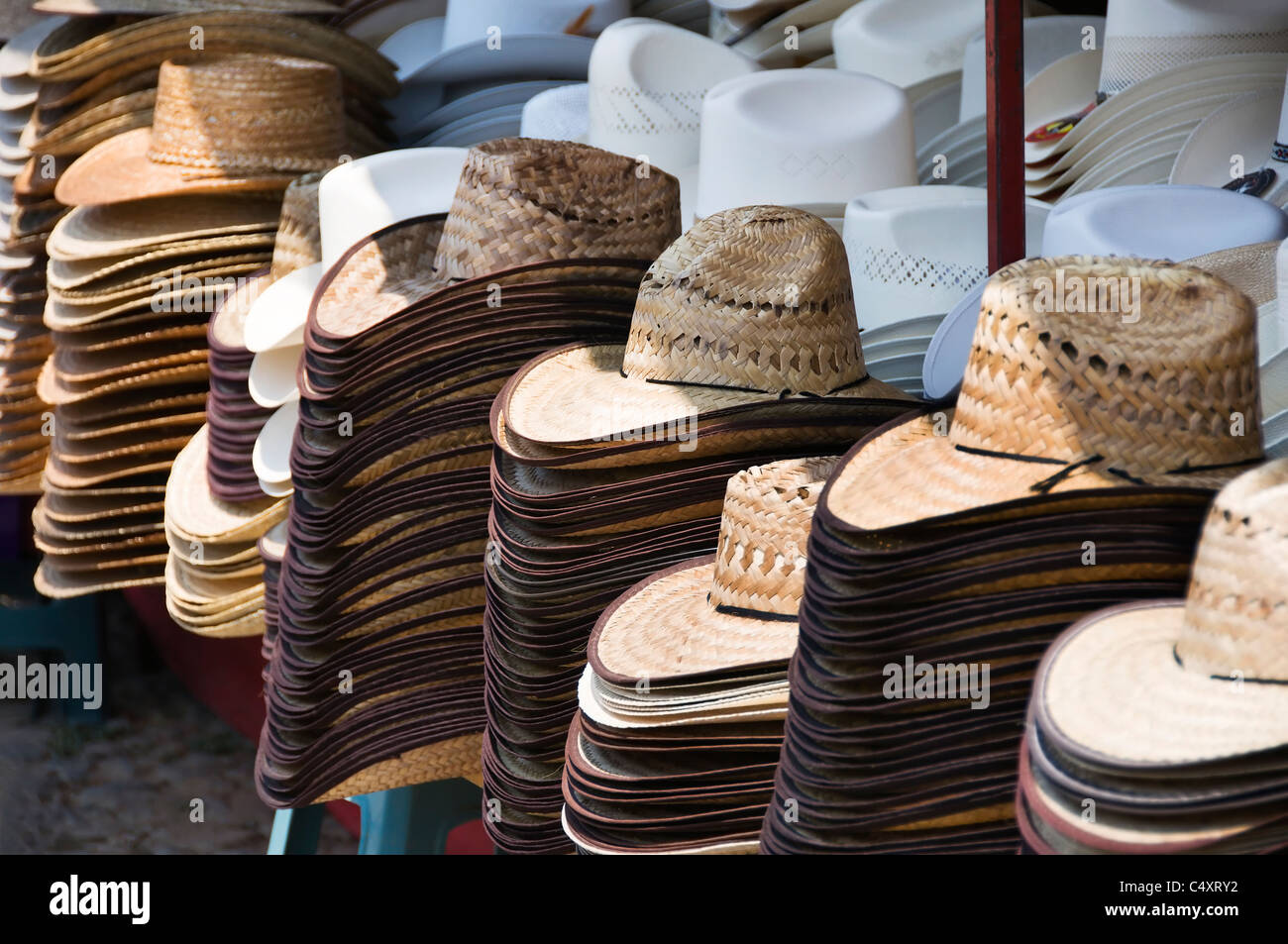 3f7cf5d7ba8d29 A variety of hats are stacked for sale at this outdoor market stall in  Talpa de