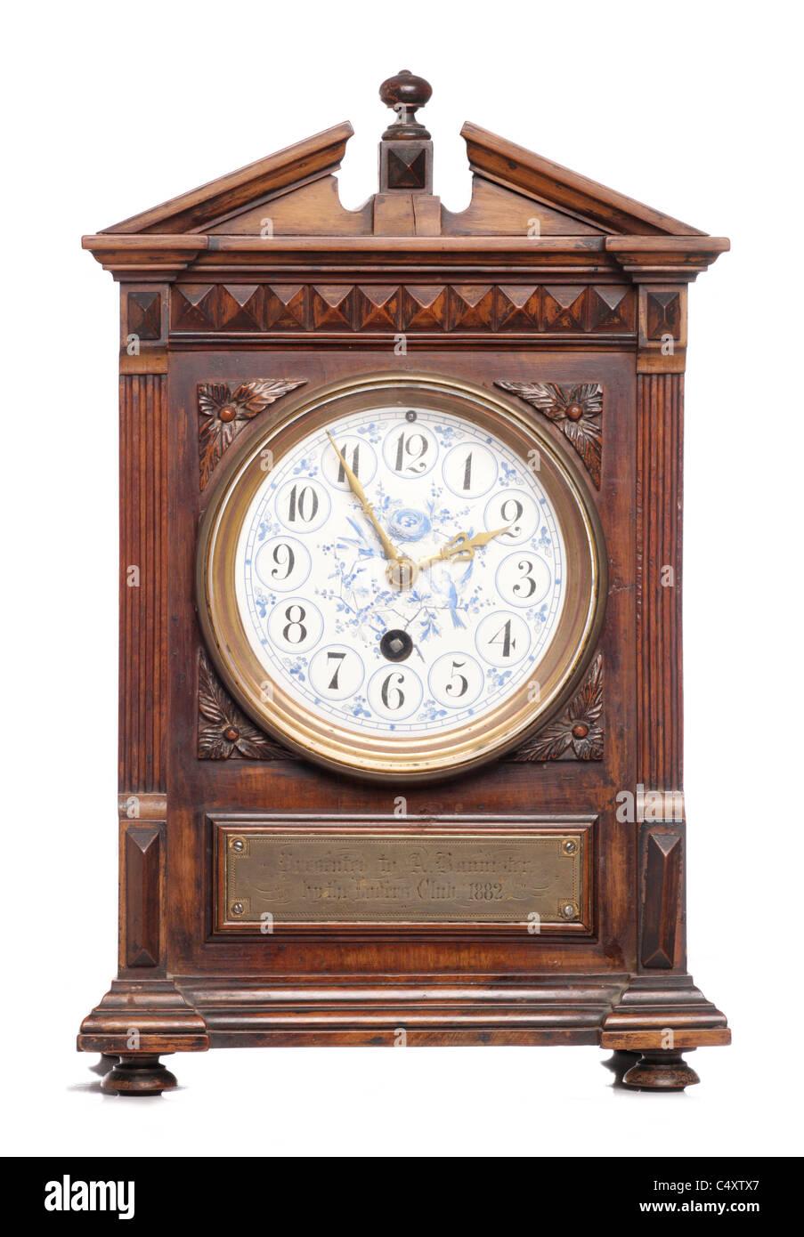 antique clock isolated on white background - Stock Image