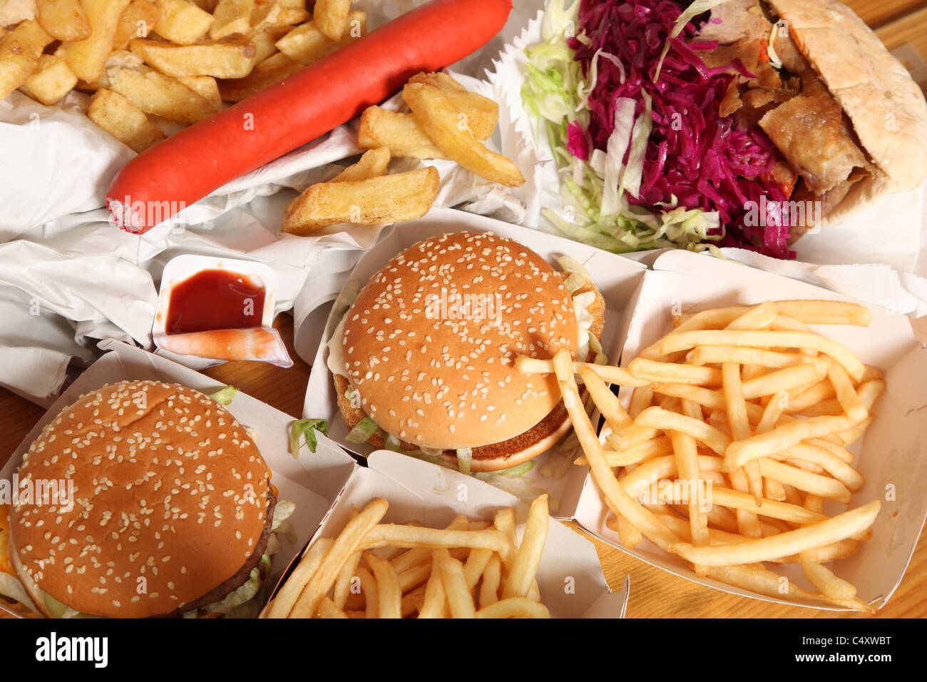 Hamburgers, kebab, chips and other unhealthy fatty fried foods. - Stock Image