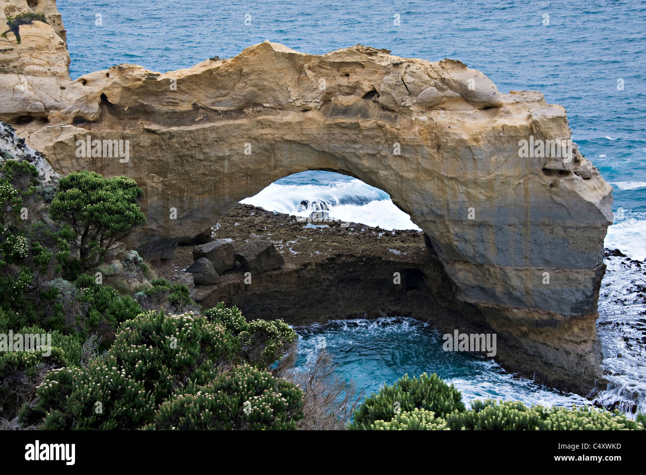 Archway Formed by Erosion by Sea in Rocks on the Great Ocean Road near Port Campbell Victoria Australia - Stock Image