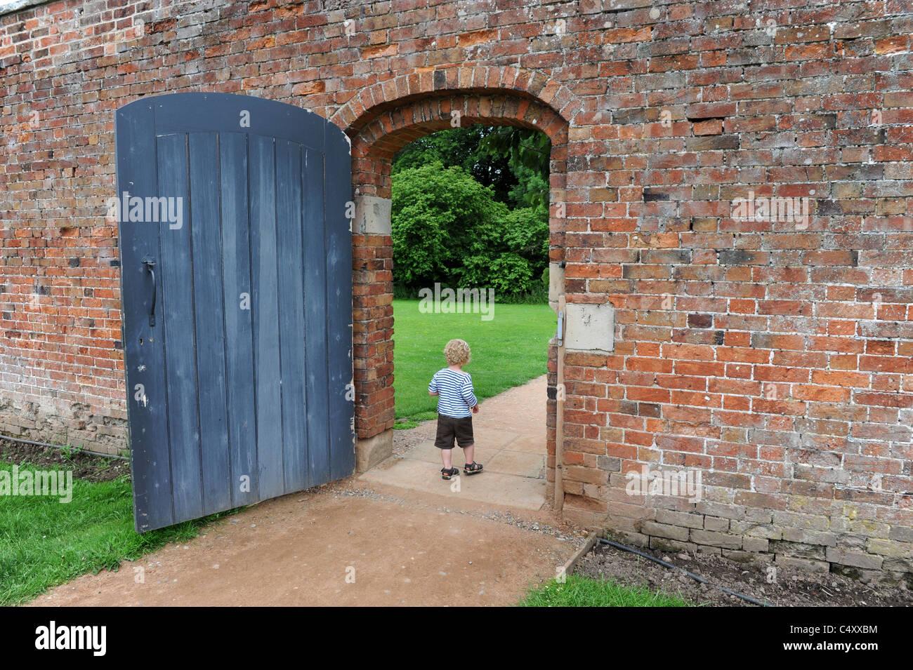 Attractive Toddler Walking Through Garden Gate Left Wide Open Uk