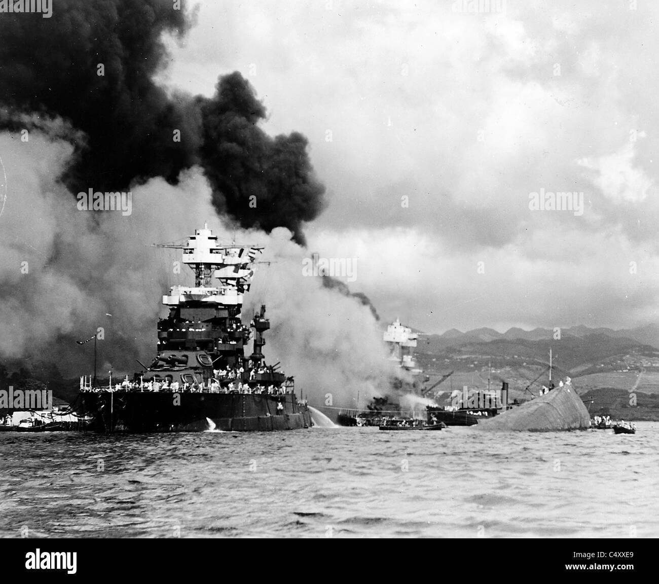Maryland alongside the capsized Oklahoma at Pearl Harbor, Hawaii. Stock Photo
