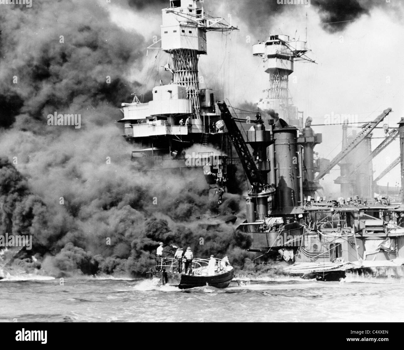 USS West Virginia burning after the attack on at Pearl Harbor, Hawaii. Stock Photo