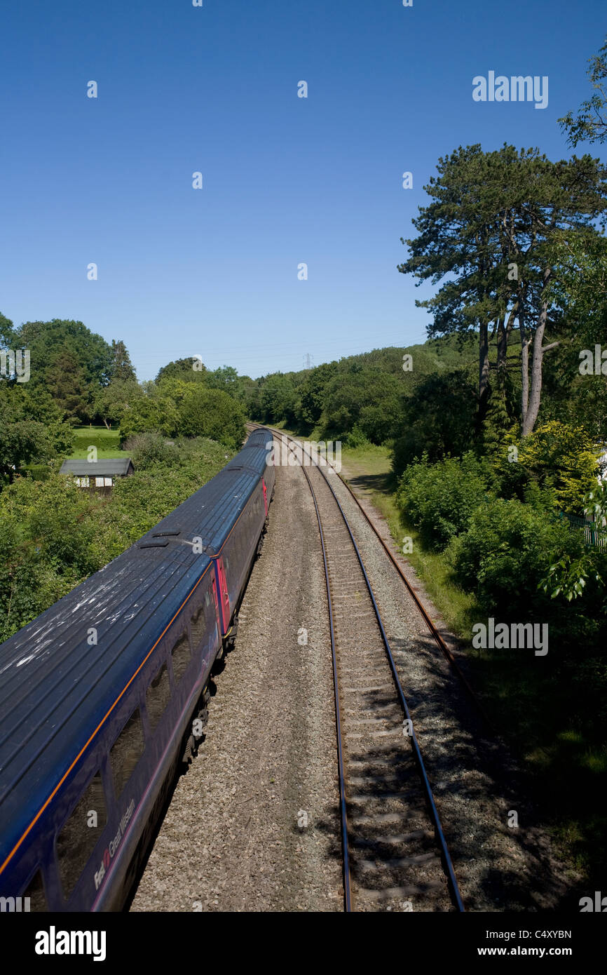 Railway lines and tracks with diesel high speed train in vale of Glamorgan, Wales - Stock Image