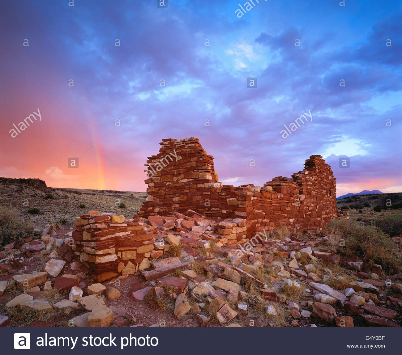 Box Canyon ruins with summer storm and rainbow at sunset. [Kayenta Anasazi culture]. Wupatki National Monument, - Stock Image