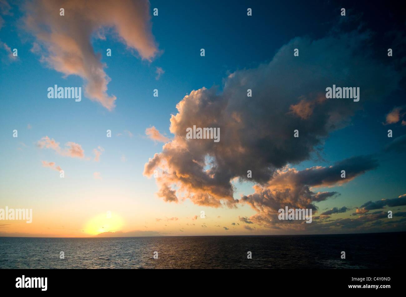 Sunset over Great Barrier Reef northeast of Cairns in Queensland Australia - Stock Image