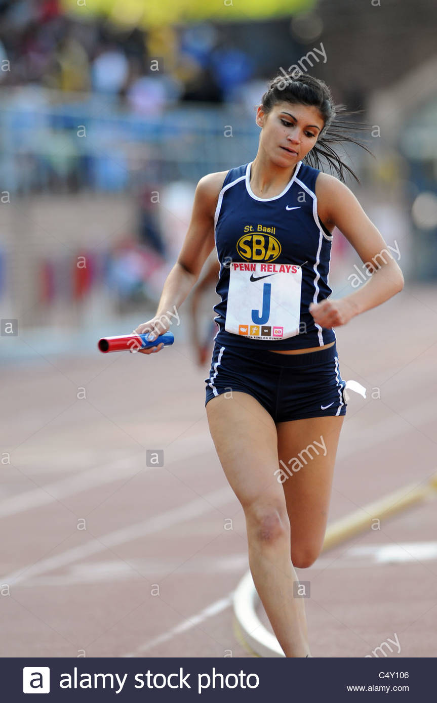 St. Basil's Academy female runner competes in a relay event at the 2011 Penn Relays - Stock Image