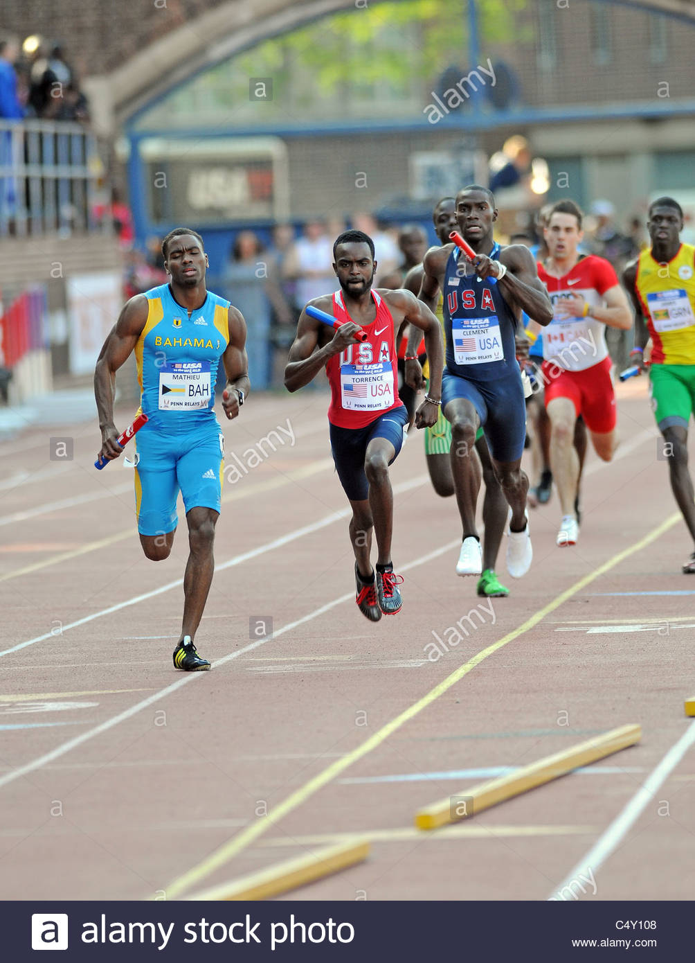 4x400 Olympic Development Men's Relay at the 2011 Penn Relays - teams from the USA and Bahamas shown - Stock Image