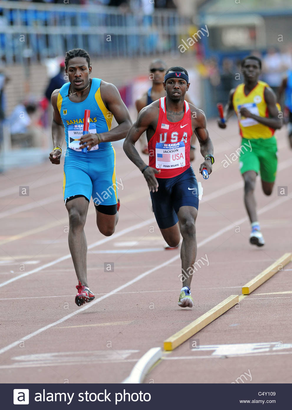 Andrae Willliams (l) from the Bahamas and Bershawn Jackson (r) from the USA at the 2011 Penn Relays 4x400 - Stock Image