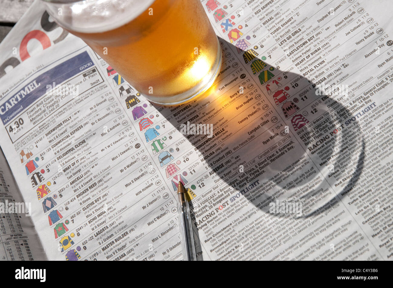 horse racing post newspaper and pint of beer - Stock Image