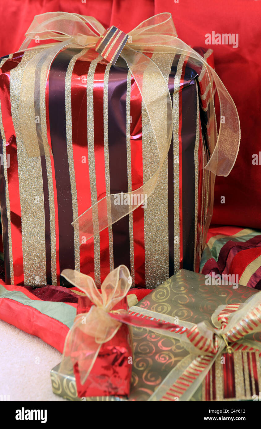 Christmas presents wrapped and with ribbons and bows - Stock Image