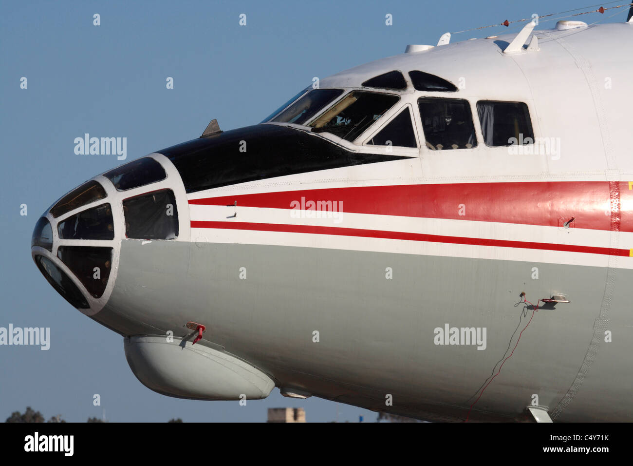 Close-up of the nose section of an Antonov An-12 cargo plane, with its strong resemblance to a World War II bomber - Stock Image