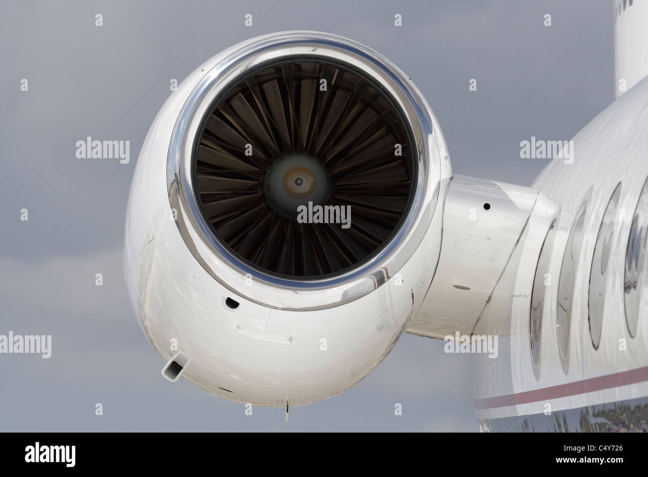 Closeup of a turbofan jet engine on a private jet. No proprietary details visible. - Stock Image