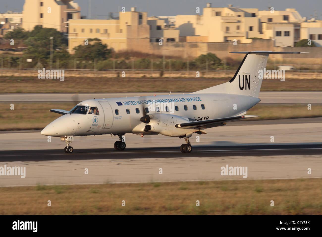 Embraer EMB 120 Brasilia of the United Nations landing in Malta during humanitarian operations in Libya, 19 June - Stock Image