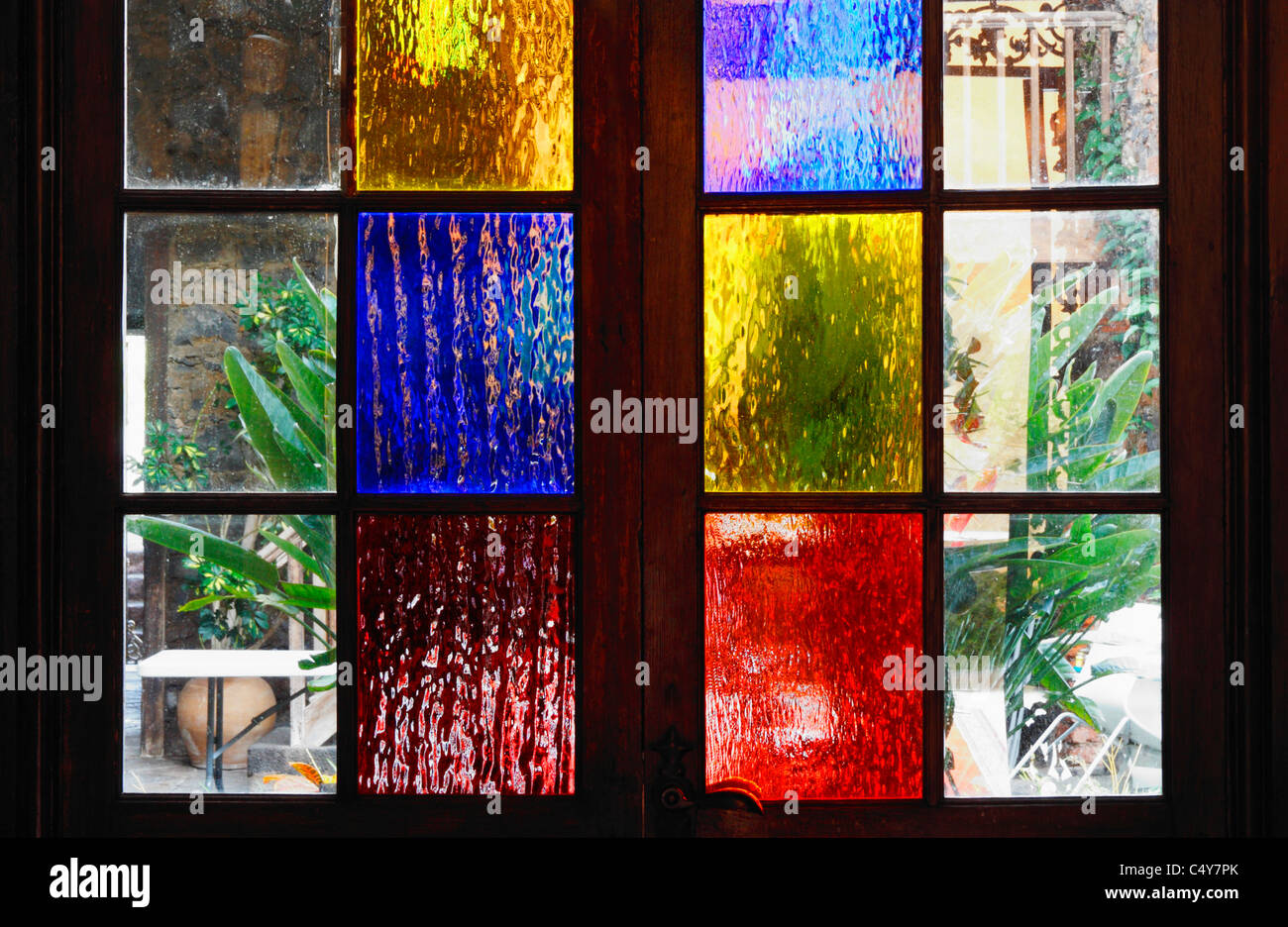 Coloured Frosted Glass Panels On Door Leading To Patio In House In Spain