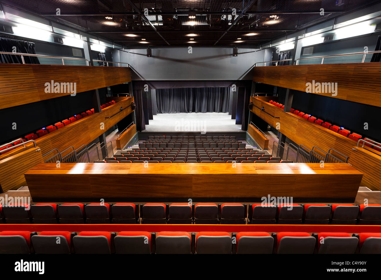 stepped seating on the auditorium of Berry Theatre looking towards the stage - Stock Image