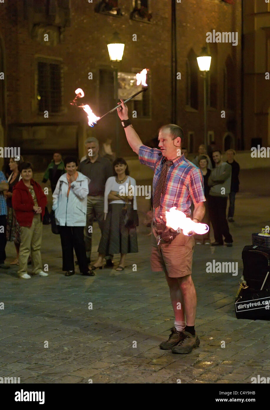 People watching a juggler's fire performance on the market square, Wroclaw, Poland - Stock Image