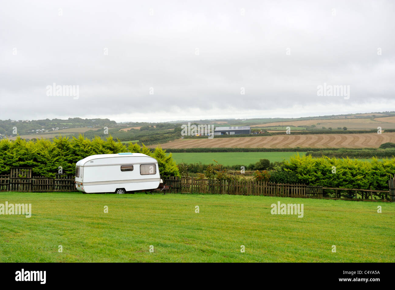Overcast day with caravan in field, north Cornwall - Stock Image