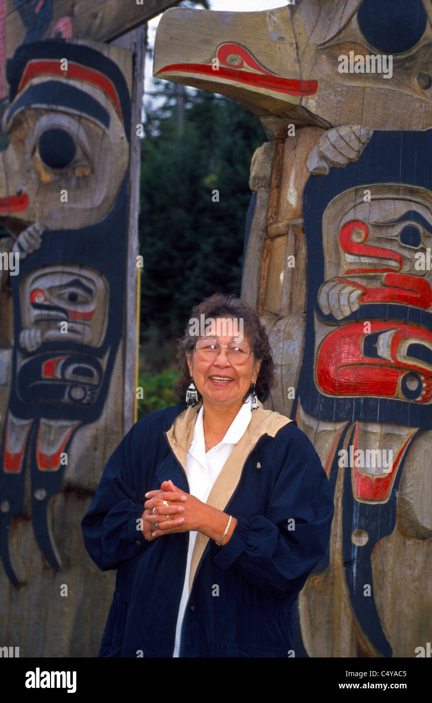 A Tlingit Native Alaskan and tribal elder describes her Indian people's totem poles in the village of Kake on - Stock Image