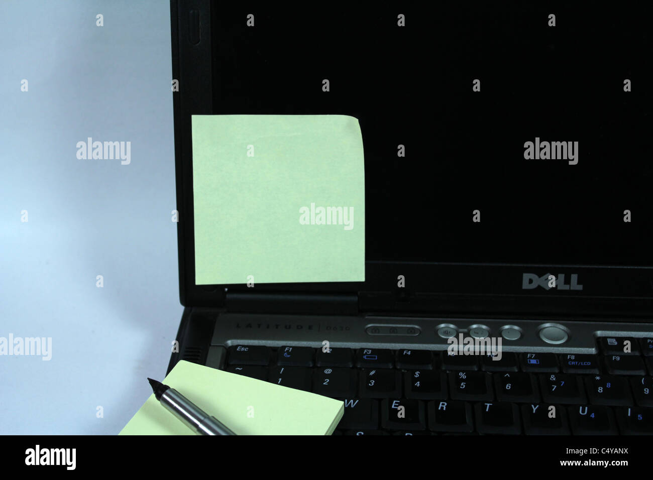 blank post it note on a laptop - Stock Image