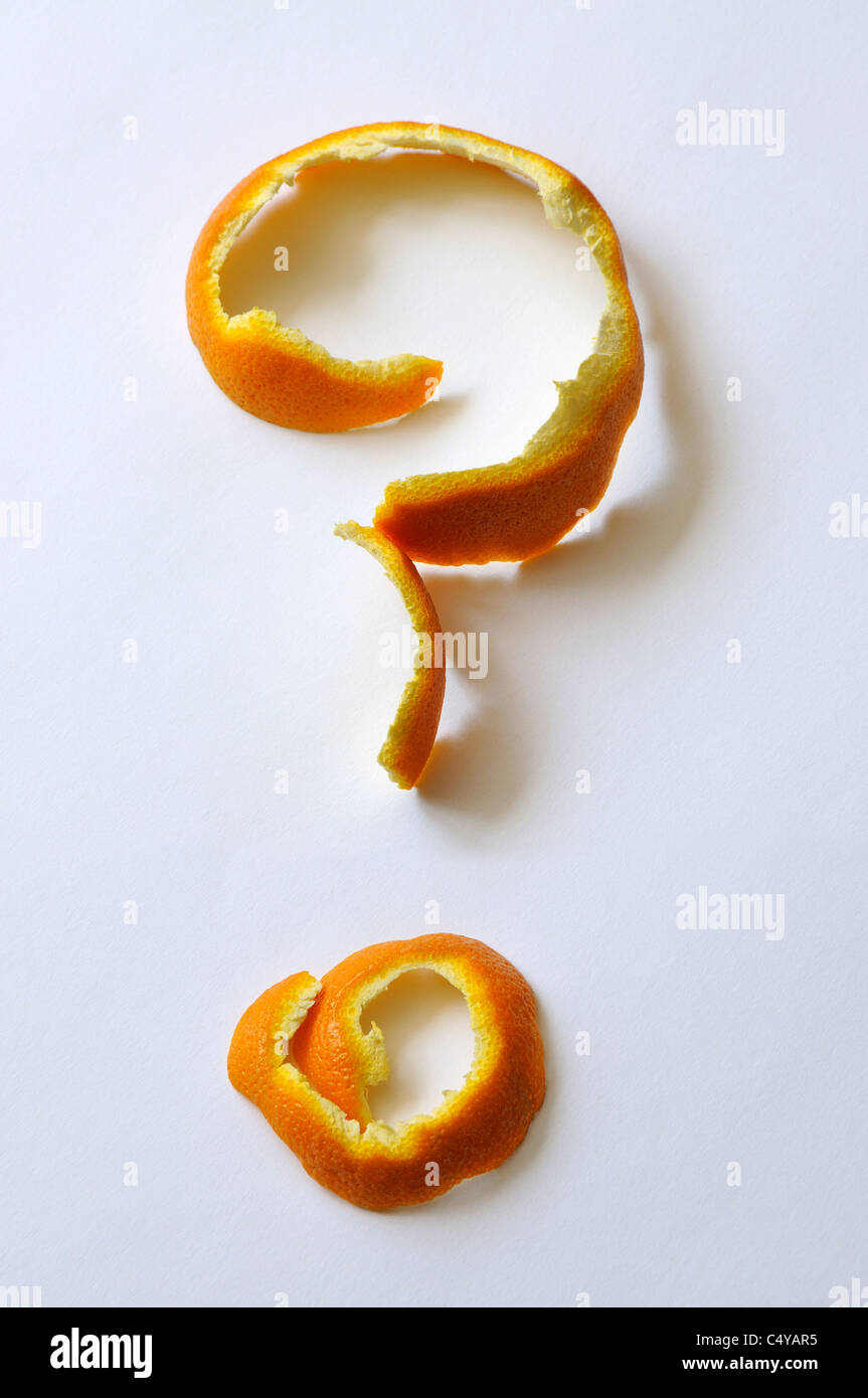 orange peel in the shape of a question mark - Stock Image