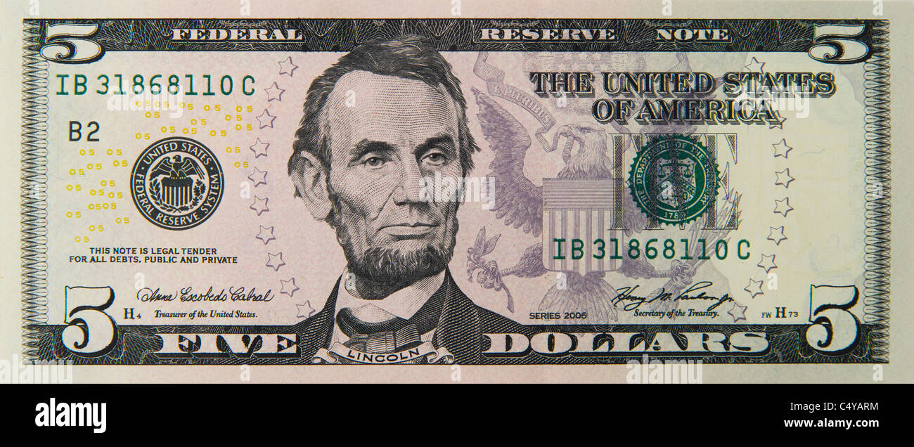 five 5 dollar dollars bill note bills notes - Stock Image