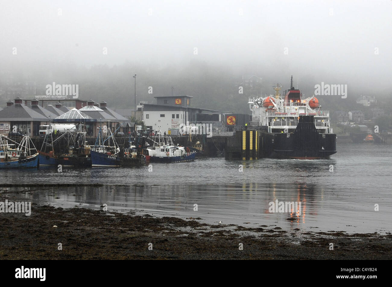 Oban Ferry Terminal in bad weather with docked ferry Scotland - Stock Image