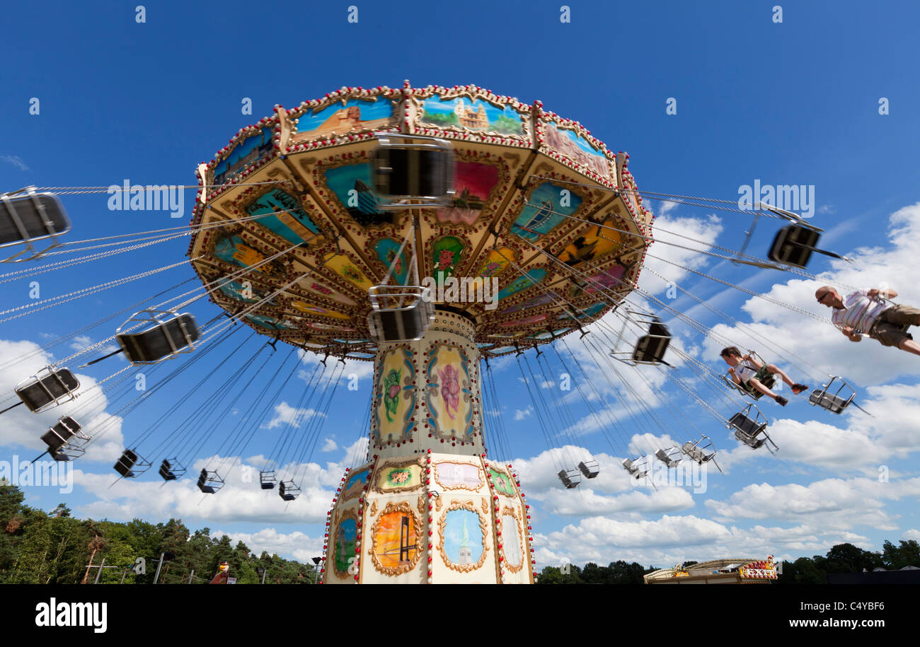 Chain carousel ride in an amusement parks carnivals or funfair UK England Stock Photo