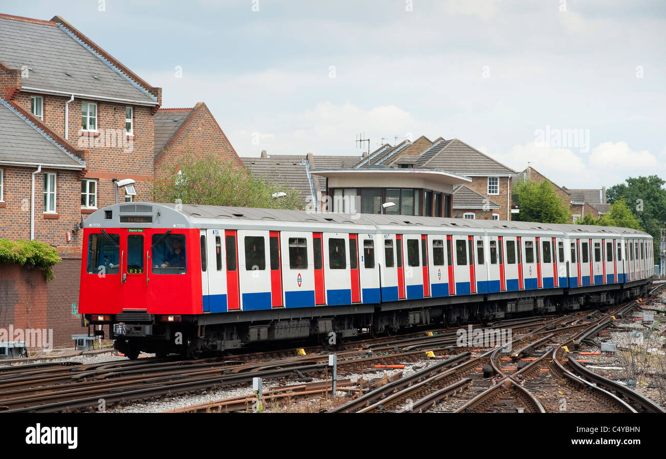 London Underground travelling overground on the District Line, London, England. - Stock Image