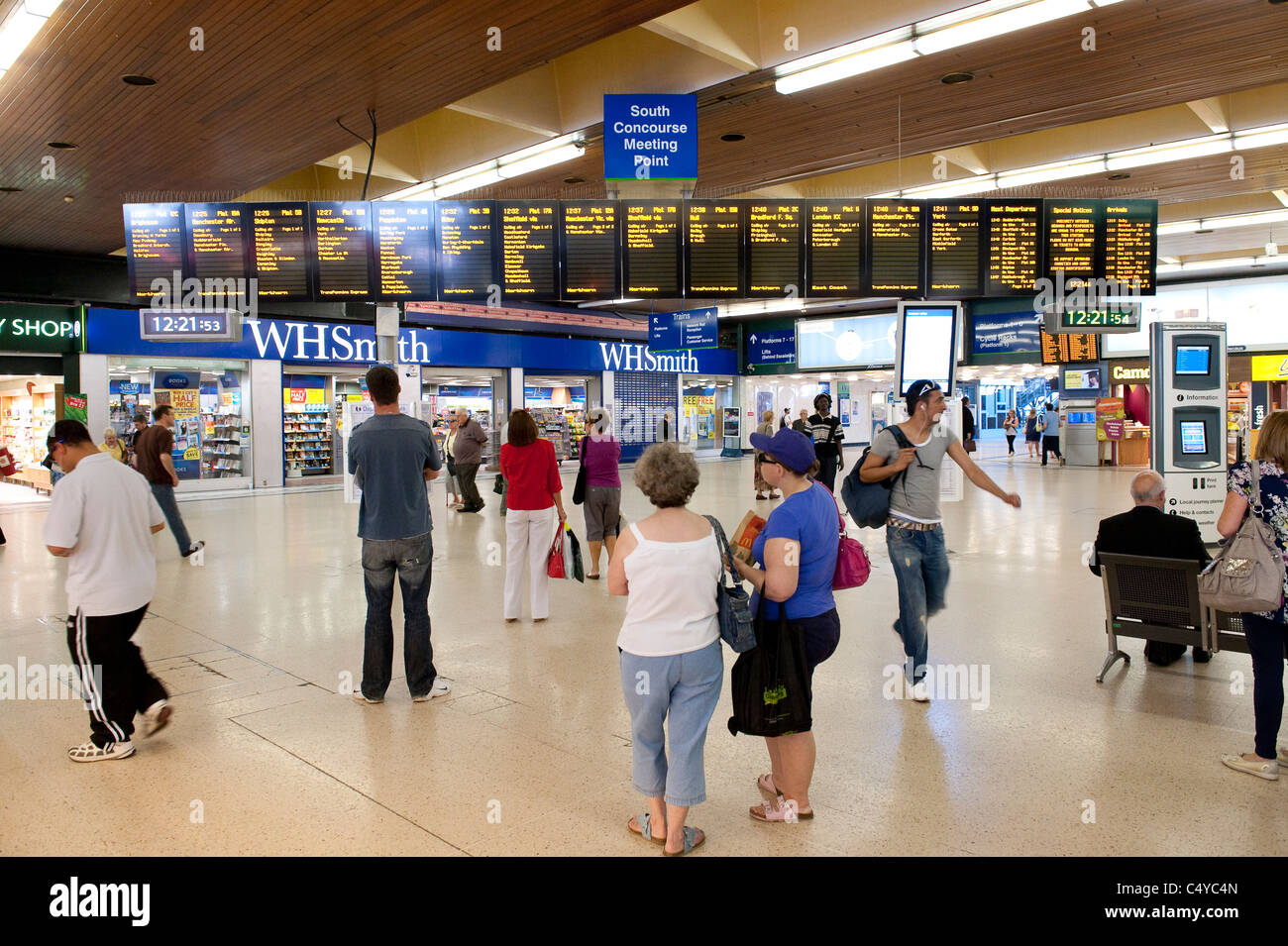Passengers checking the arrival and departure information boards on the concourse area of Leeds railway station, - Stock Image