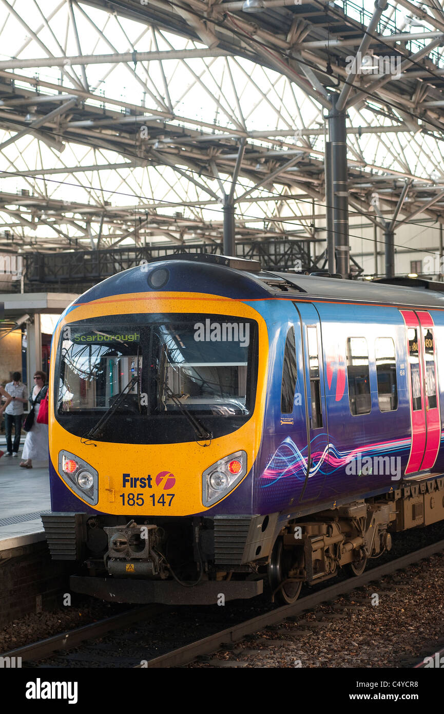 Class 185 train in First Transpennine livery waiting at a railway station in England. - Stock Image