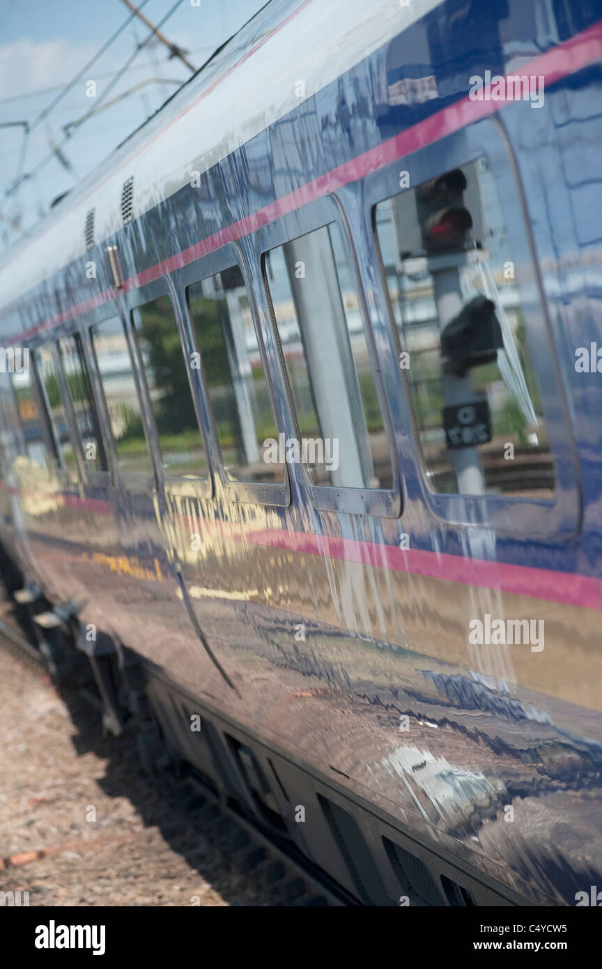 Close up view of the side of carriages on a train, England. - Stock Image