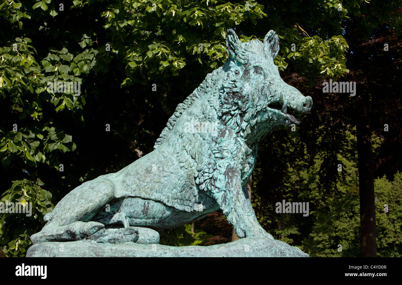 a bronze boar sculpture in the park of Enghien, Province of Hainaut, Wallonia, Belgium, Europe; - Stock Image