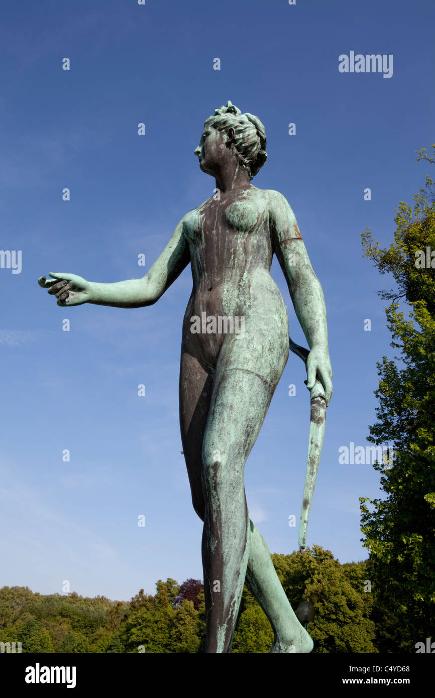 Mythological sculpture  of hunting goddess Diana in the park of Enghien, Belgium, Europe - Stock Image