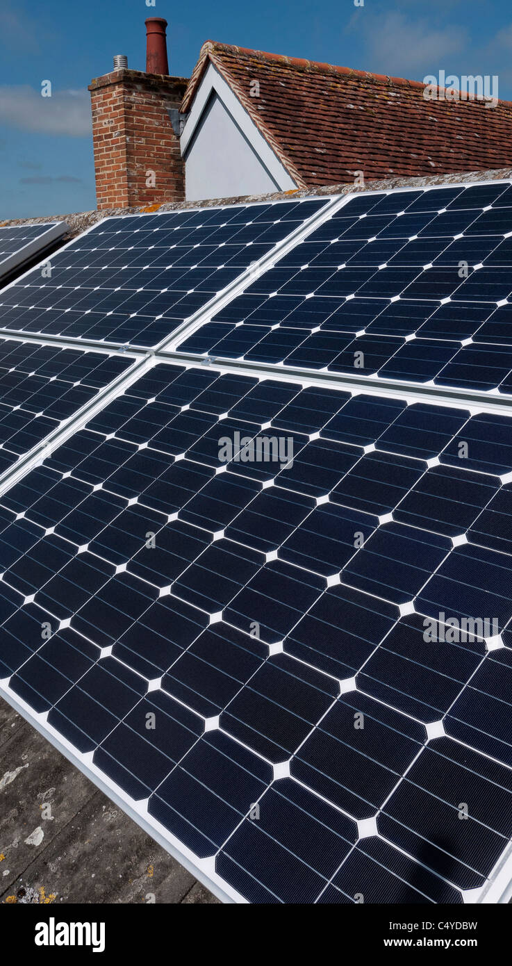 Solar panels installed on roof of residential house in England - Stock Image