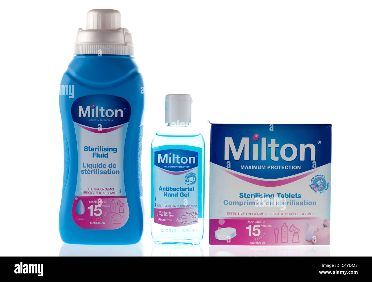 Three Milton products Sterilising fluid and antibacterial rinse free hand gel and sterilising tablets - Stock Image