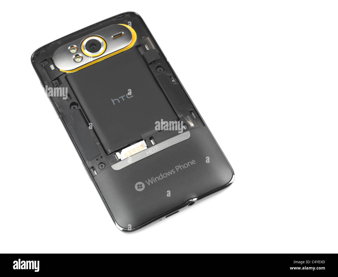 Windows 7 phone. HTC HD7 smartphone with a rear panel taken off showing the  lithium ion battery - Stock Image