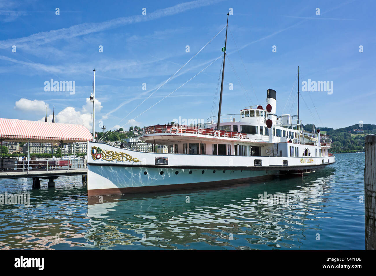 Swiss paddle steamer Stadt Luzern moored at pier in Lucerne on the Lake Lucerne awaiging passengers - Stock Image