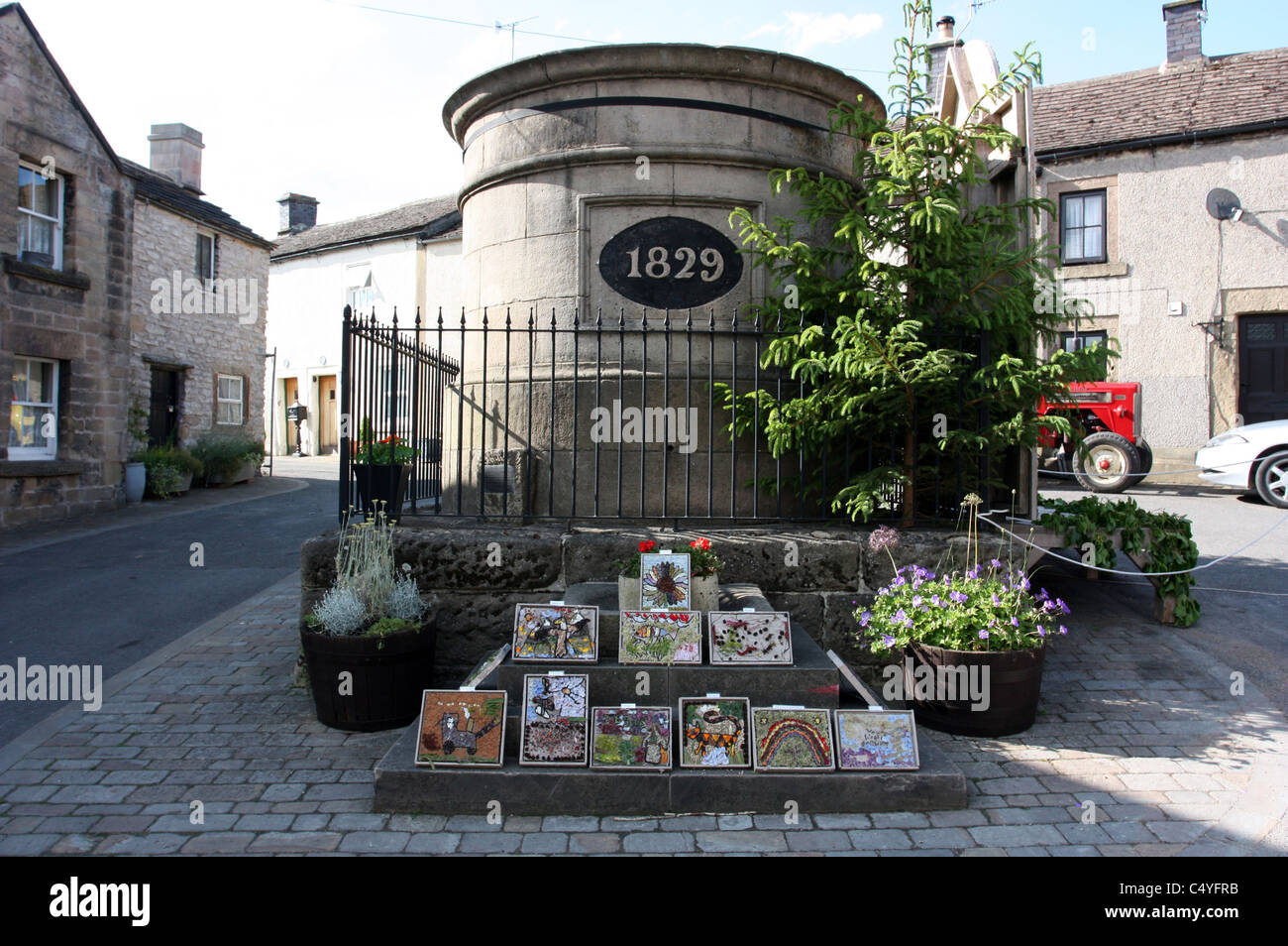 The Fountain Water Tank in Youlgreave with the 2011 Childrens Well Dressings - Stock Image