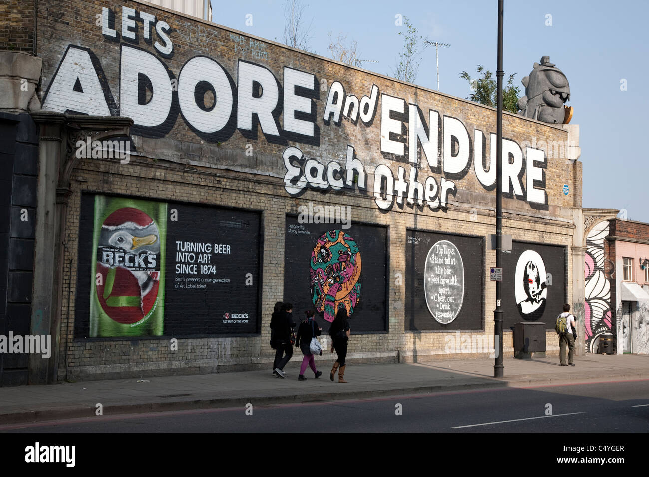 Lets Adore and Endure Each Other - Art Mural by Stefan Powers in Shoreditch London - Stock Image