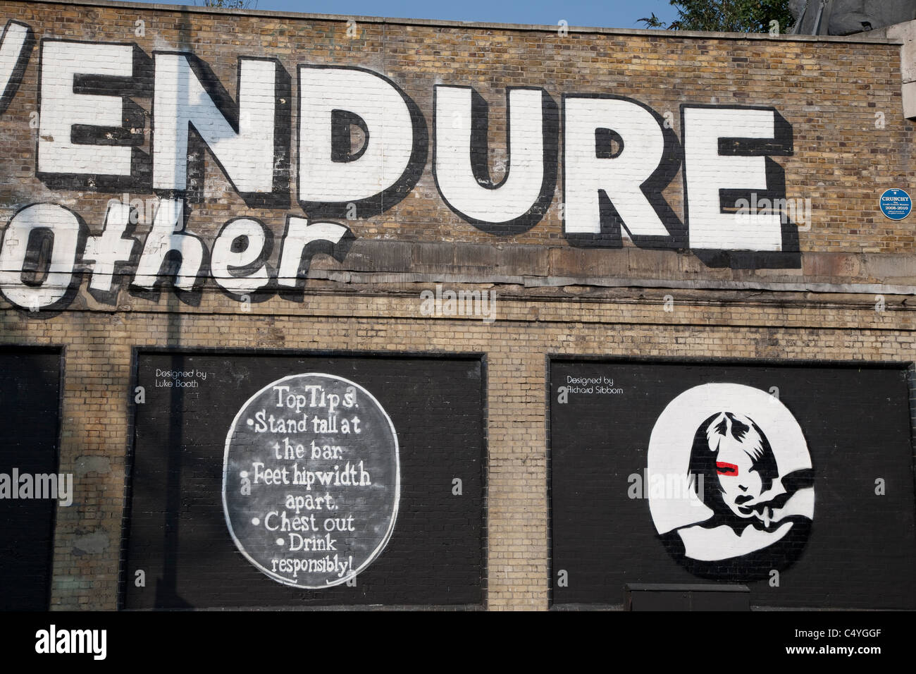 Lets Adore and Endure Each Other Stefan Powers - Art Mural in Shoreditch London with designs from Luke Booth and - Stock Image